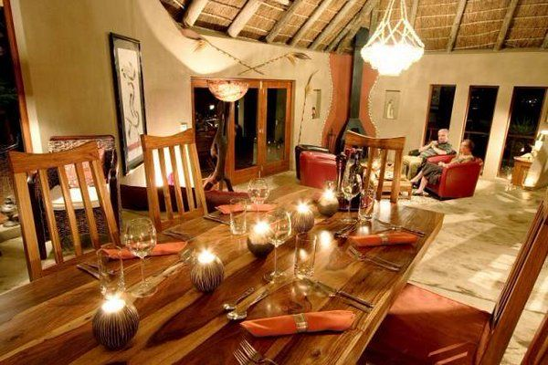 Welcoming lounge / dining area at Bush Lodge in Sibuya Game Reserve. For the more Luxury traveller there is only 4 Luxury Chalets and well trained staff and game rangers to look after your every need. Kenton on Sea, Eastern Cape, South Africa www.sibuya.co.za
