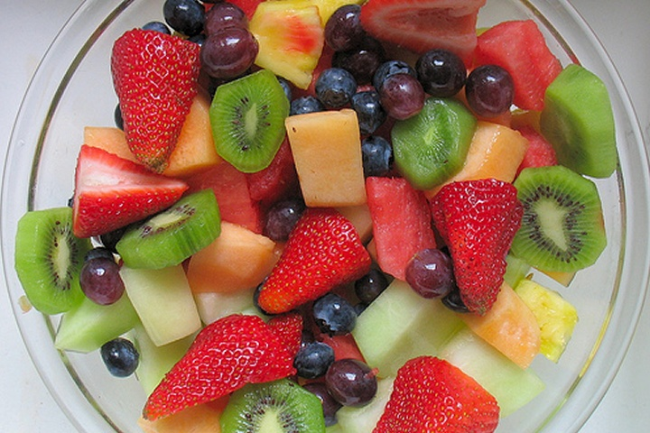 Healthy Fruit Salad with cantaloupe, watermelon, red grapes, strawberries, and kiwis