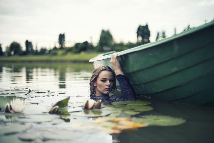 Woman in lake by Tomasz Cieślak on 500px