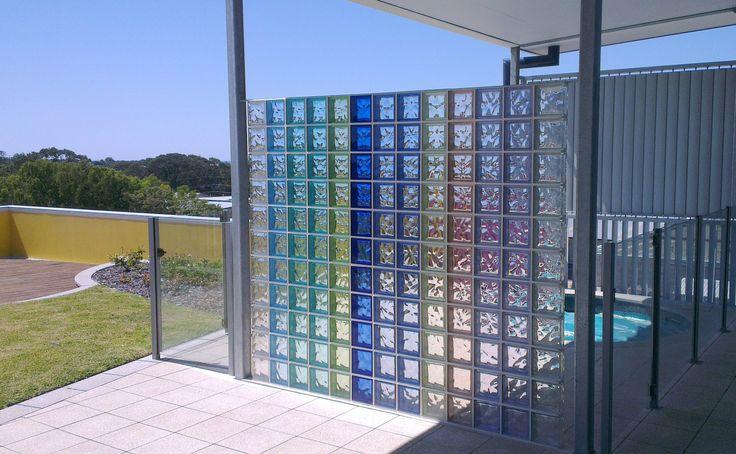 Coloured glass blocks make a beautiful screen for a spa pool