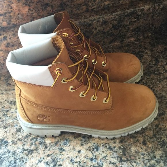 Timberland WaterProof Boots. I don't trade sorry Timberland waterproof boots with white trim at the top. Only worn about 3/4 times. Good condition. Few black marks on the back bottom part of the shoe as shown in the photo. Timberland Shoes