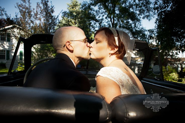 Vintage car convertible wedding kiss