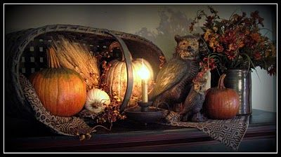 Old Basket Fall display...pumpkins, lighted candle, woven textile, and owls...
