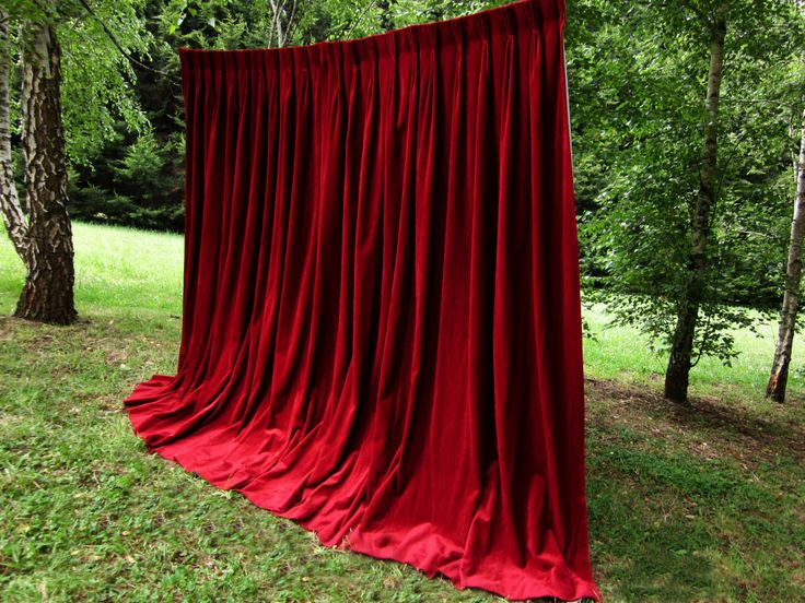 Red velvet Photo Booth backdrop for a touch of old world elegance.