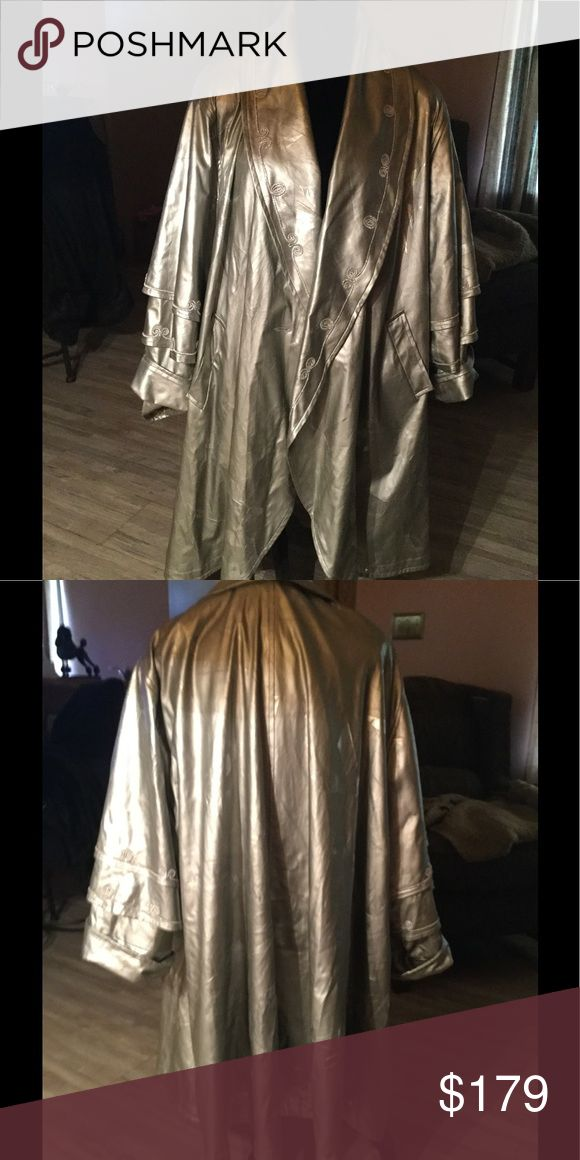 Ladies Raincoat Silver with silver threading trim.  Very pretty Jackets & Coats
