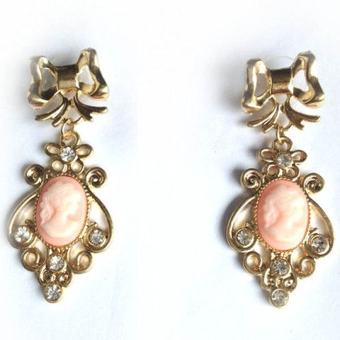 Vintage Style Cameo Bow Earrings. Vintage style gold-coloured drop earrings, with a pretty gold bow stud and a pink cameo set against a vintage-style gold and crystals setting.