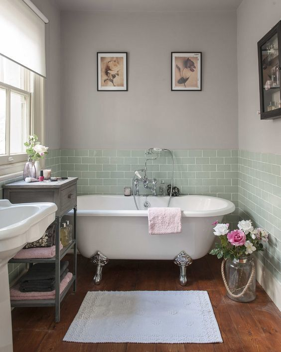 This bathroom is all-out vintage – from the roll top bath and traditional basin, to the small quirky table and the vintage jar full of flowers