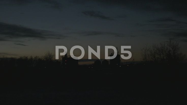 Slow Motion Driving Past Power Plant Dusk Night Silhouette Trees Hand Held - Stock Footage   by RyanJonesFilms