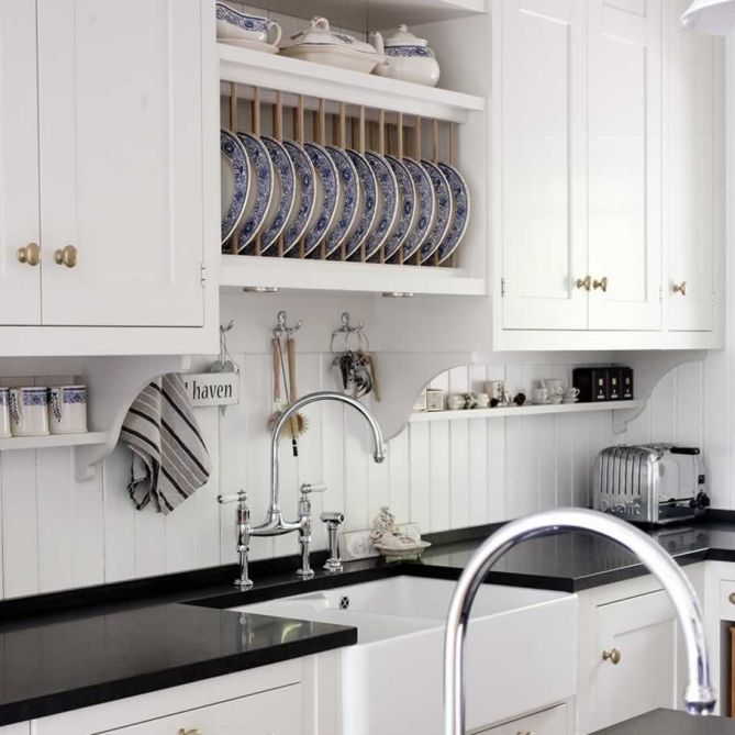Kvanum - Crisp white kitchen with black quartz countertops - beadboard backsplash