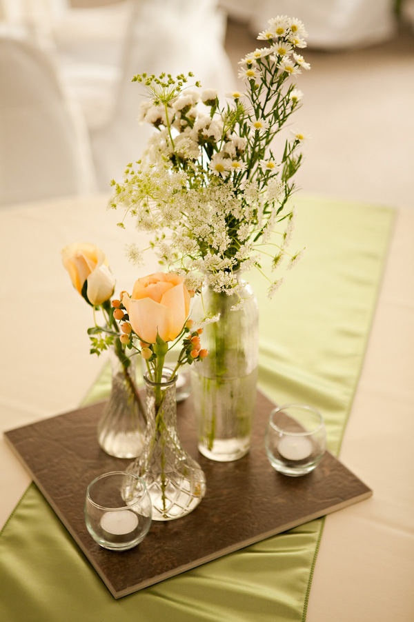 table centerpiece. like the simple runner and block... i'd mix in vases and wine bottles.
