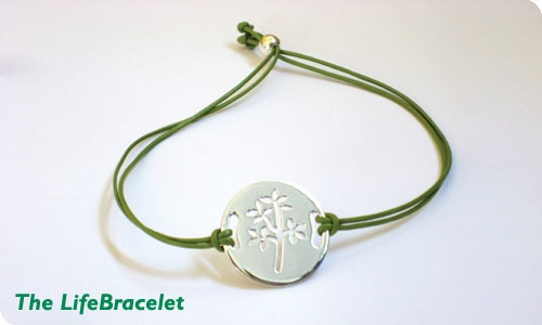 The Bone Marrow Foundation's tree of life cut into an elegant sterling silver disc,   on a thin green leather band. $25