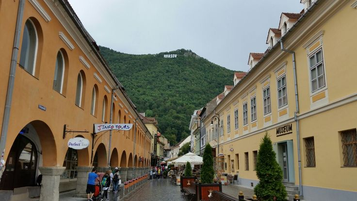 Commercial street with a view to Tampa mountains located next to Brasov, Transylvania, Romania.  The name of the city is displayed on the mountains, similar with Hollywood hills sign. #trivo