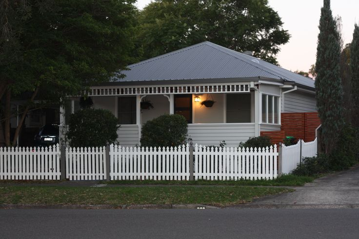 Wallaby Colourbond roof (& fence trims), Resene Quarter Foggy Grey - house colour, Resene Quarter Wan White - Trims & fence, Resene Grey Friars - door, Resene Masala - garden wood trims