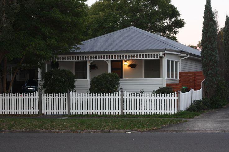 Wallaby Colourbond roof (& fence trims), Resene Quarter Foggy Grey - house colour, Resene Quarter Wan White - Trims & fence, Resene Grey Friars - door, Resene Masala - garden wood trims