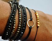 Karma bracelet.  Sterling silver.  -Baby Karma bracelet -on Gray waxed Irish linen cord thread. $32.00, via Etsy.
