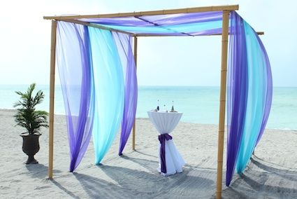 Purple bamboo trellis and sashes for FL beach wedding love love love love this look