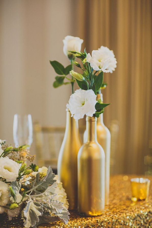 Elegant gold painted wine bottle vases (Photo by Ryan Horban Photography)
