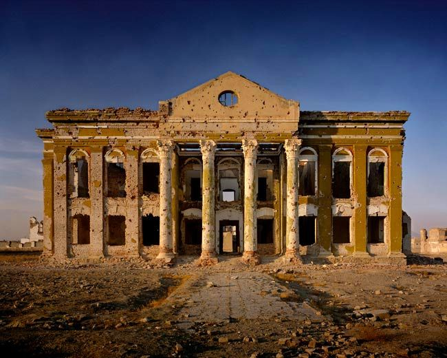 Simon Norfolk - A government building close to the former Presidential Palace at Darulaman, Afghanistan. Looking at that particular photo from the Afghanistan series, Norfolk clearly tried to show the grandeur of the place and the building. Even in desolation, it still stands to time's testimony. Norfolk somehow manages to capture that past glory over shadowing the ravages of war. Brilliant composition and perfect shot.
