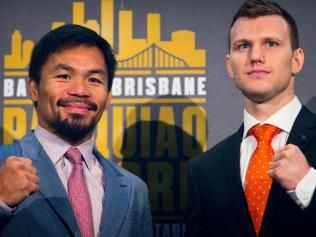 (FILES) This file photo taken on June 28, 2017 shows Philippine boxer Manny Pacquiao (L) and Australian challenger Jeff Horn posing after a press conference to promote their upcoming WBO welterweight boxing title fight at Suncorp Stadium in Brisbane. Filipino legend Manny Pacquiao faces unheralded Australian challenger Jeff Horn in his world welterweight title fight on July 2, 2017 in Brisbane in pursuit of a dream rematch with Floyd Mayweather. / AFP PHOTO / Patrick HAMILTON / -- IMAGE…
