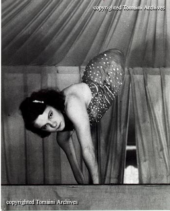 "Jeanie Tomaini was born August 23, 1916 as Berniece Smith, Died August 10, 1999 Gibsonton, Florida. She was known in her day as the ""World's Only Living Half Girl."" She was born without legs and both of her arms were twisted. She began performing at age 3, exhibited by her parents at fairs all over the country. Jeanie's act consisted mainly of acrobatic stunts such as handstands and cartwheels - although her hands were deformed, she was able to walk on them with ease."