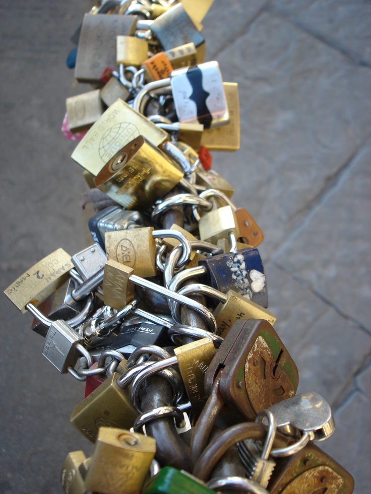 Locks of love. Florence, Italy.  There are locks of love in Paris too! Just don't get caught putting one on It's a big fine! What you do is your and someone you care about boyfriend/girlfriend or best friend put the lock on the fence and then throw the key in the river or ocean symbolizing the relationship is locked and will last.
