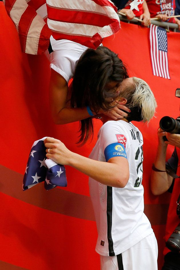 U.S. soccer player Abby Wambach celebrates with wife Sarah Huffman after the U.S. team's 5-2 victory against Japan in the FIFA Women's World Cup on July 5, 2015, in Vancouver, Canada.