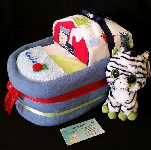 SMALL BASSINET Baby Gift Shalea Gifts Design  Contains – 30 Infant Nappies, 1 Baby Singlet, 1 Baby Winter/Summer Onsie, 2 x Baby Bibs, 1 Baby Wrap/Blanket 1 Over the Shoulder Burp Cloth, 2 Baby Wash Cloths, 1 x Sml Plush Toy Decorated Embellished, Finished with Cellophane and Ribbon
