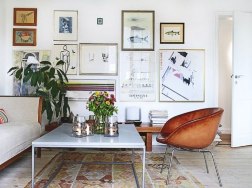 Eclectic Gallery Wall Of Vintage Prints And Modern Art In A Contemporary Neutral Living Room I Love The Large Marble Top Cocktail Table Leather