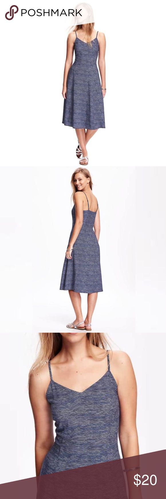 Old Navy Cami Dress in Blue Wave Stripe Sweetheart neckline; adjustable spaghetti straps. Elasticized back; hidden side zipper. All over print. Soft, lightweight woven rayon. Slightly fitted through body. Dress hits below knee. Old Navy Dresses Midi