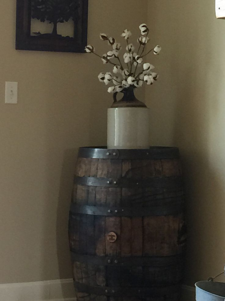 Jack Daniels whiskey barrel, old jug and cotton stems. Becca, my good friend, helped me with this idea.  Love it.