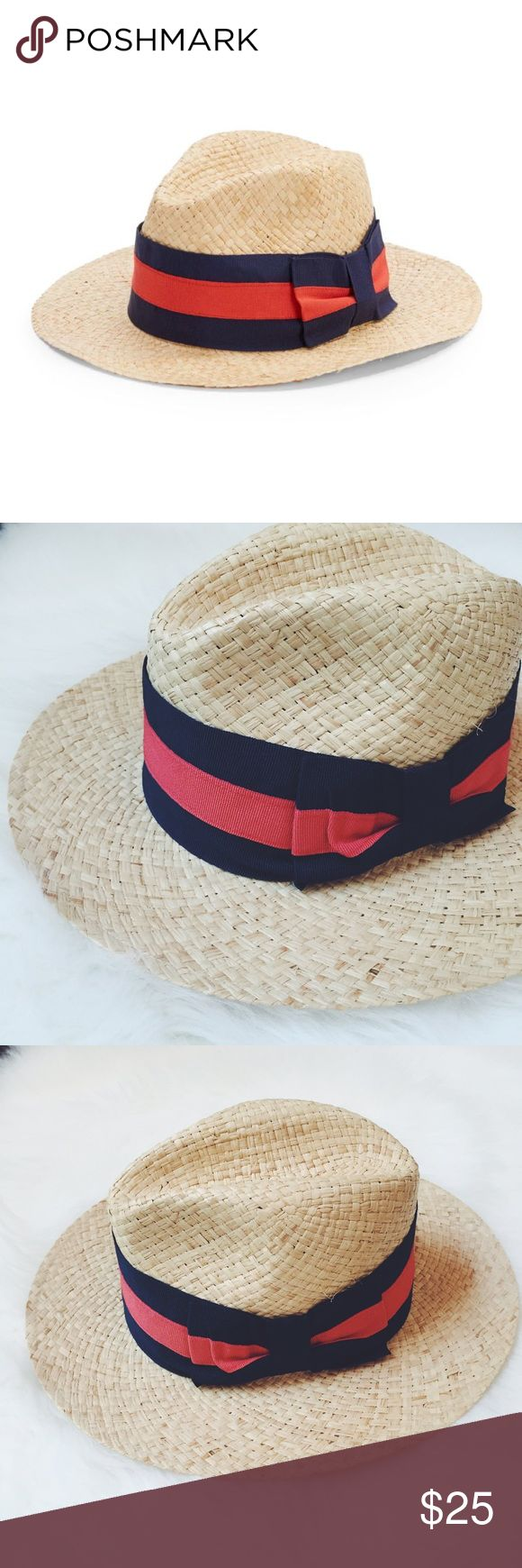 Saks Fifth Avenue Straw Hat Saks Fifth Avenue made in Italy Straw hat, 100% natural straw, do not wash, do not dry clean, do not bleach, do not iron. Color of the band/bow is navy/red. Brand new without tags, never wore it. Just asking what I paid for. Saks Fifth Avenue Accessories Hats