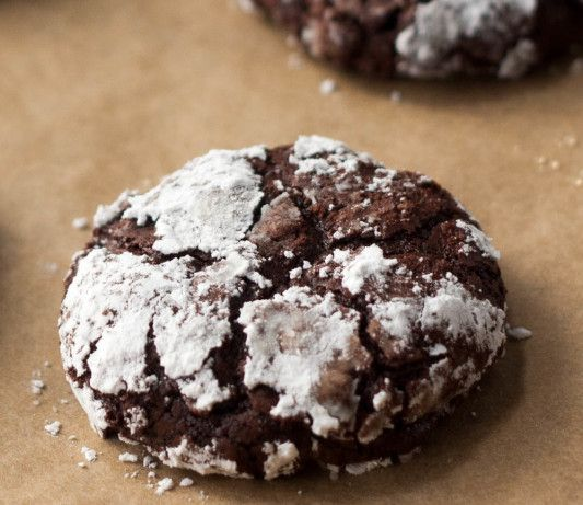 These dense and chewy cookies are made without butter or flour, and have an intense chocolate flavour. This recipe is from the Bon Appetit Test Kitchen (Bon Appetit Magazine, June 2008). Can also roll cookies in sugar prior to baking.