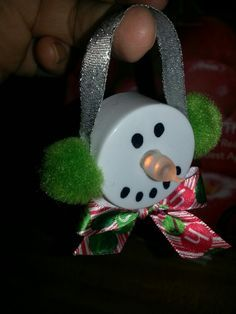 Snowman ornament made with a battery operated tea light.