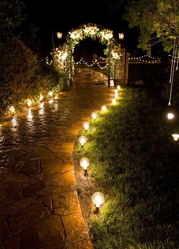 A pathway flanked with lights makes you feel as if you're walking through an enchanted garden. wedding lighting, outdoor wedding ideas