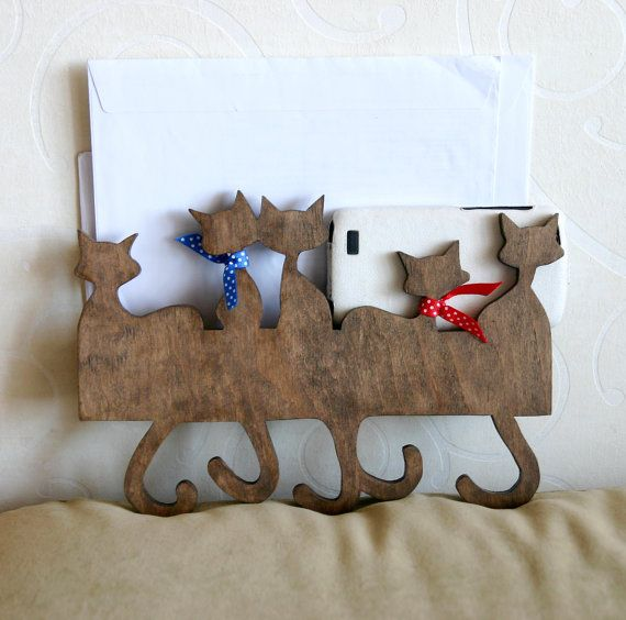 Five cats shaped wooden key and mail holder. It can be used to hold keys, dog leashes, shoehorn, mail and simply as decoration for your home.