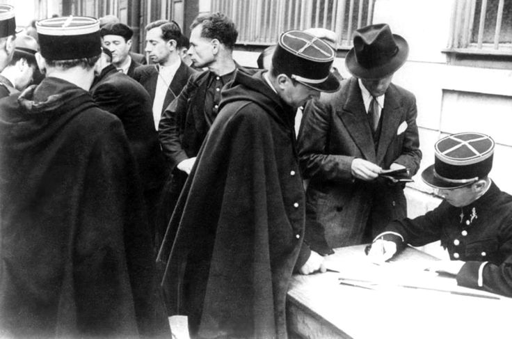 "French Jews in Paris are forced to register with authorities, showing French police their passports. The first anti-Jewish measure of the occupying Germans was published on 27 September 1940, with the publication of the ""First Ordinance"". The measure was a census of Jews, and set out a definition of ""who is a Jew?"" The Second Ordinance was published on 18 October 1940 and proscribed various business activities for Jews. On 31 August 1941 all radios belonging to Jews were confiscated, and…"