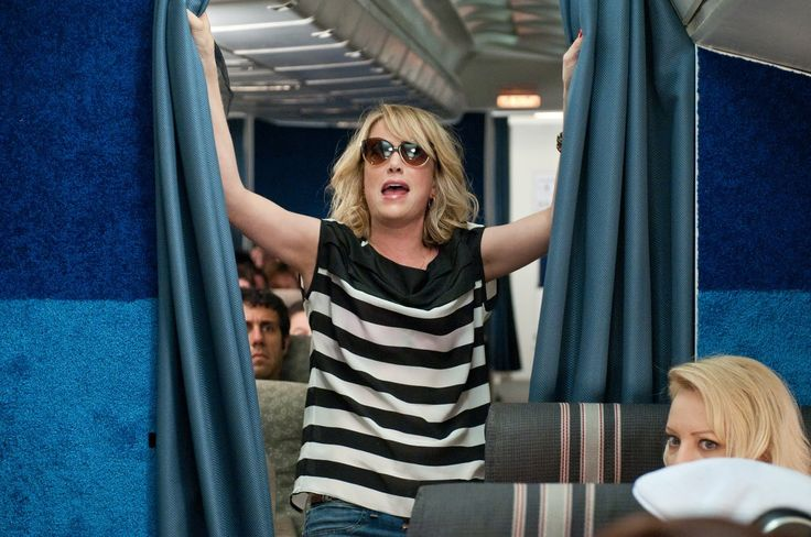 The Bridesmaids Airplane Scene.  I really love this striped shirt Kristen Wiig is wearing.