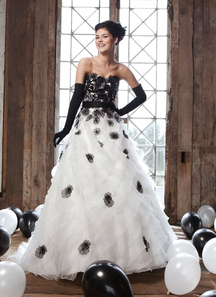 White wedding dress with black lace flowers