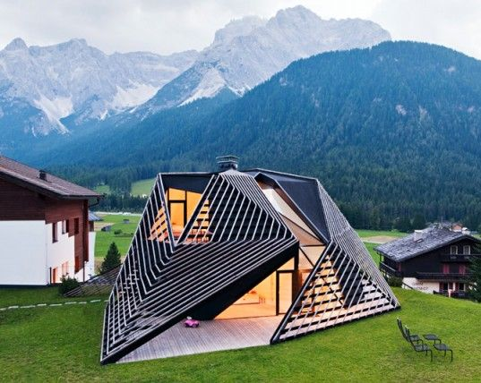 Located in the mountainous Italian village of Sesto, Plasma Studio's Alma Residence and boutique hotel boasts an extraordinary timber skin that is both sculptural and functional. The skin wraps around an addition to the six-room hotel, providing sheltered outdoor space. Read more: Extraordinary Timber Skin Wraps Around Alma Hotel in Italy's Dolomites | Inhabitat - Sustainable Design Innovation, Eco Architecture, Green Building