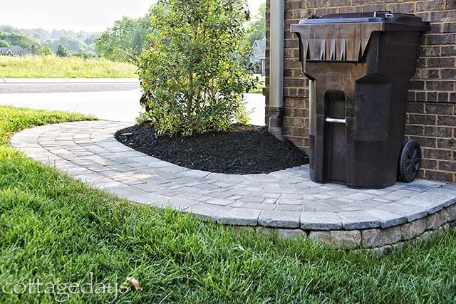 Cottage Days and Journeys: Landscaping Improvement Project  * I like both the 'sidewalk' for the trash can and the rocks around the HVAC. I would rather hide the HVAC altogether, but this might be ok. *
