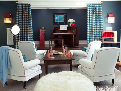 Create a place to play. Design: Windsor Smith. housebeautiful.com. #home_theater #piano #plaid_curtains #family_friendly