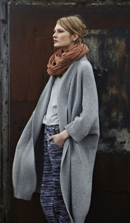 Gray t-shirt (tucked in), black and white jogger pants, gray oversized sweater coat, light brown scarf