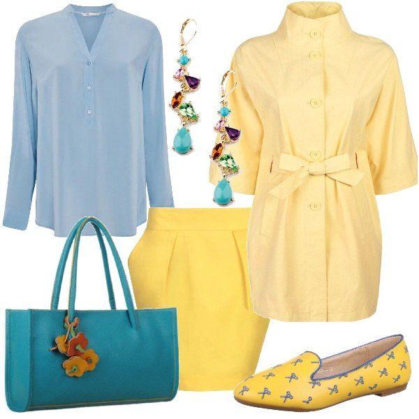 Look dai toni primaverili, gonna gialla a tulipano, camicetta azzurra, spolverino giallo con collo alla coreana e cinta in vita. Ballerina gialla con decori blu, mini shopping bag cerulea con fiori nei toni dell'arancio. Orecchini pendenti multicolor.