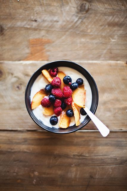 yogurt with maple syrup, peaches, raspberries and blueberries.