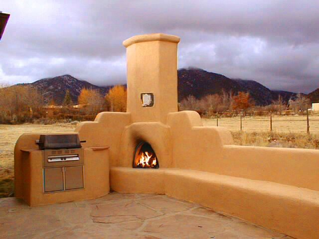 Outdoor kiva fireplace for outdoor entertaining day or night