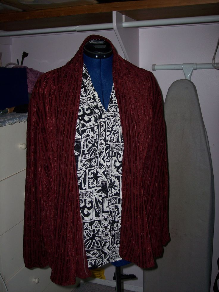 Very easy Vogue pattern for the oxblood jacket/sweater.  The black-and-white blouse was a difficult pattern but worth the effort.