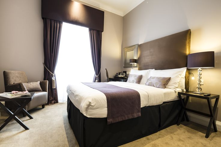 This hotel interior design project within a Grade II listed building at The Montagu Place Hotel, London Hotel, near Baker street, has been refurbished to suit its use as a boutique hotel.  The neutral bedroom interior with aubergine accents offers a contemporary interior twist to a classic scheme which is sympathetic to the Georgian building.
