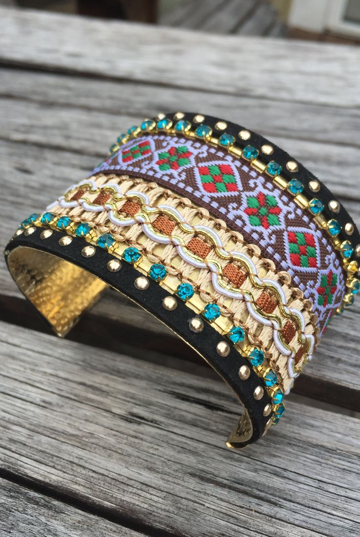 'Down The Amazon' Cuff Bracelet - This boho bracelet has a gold metallic interior with a mix of beads colorful crystals. The exterior features an elaborate embroidery detail surrounded by a trim of gold gems. Easy to get on and off, this bracelet is cool enough for a music festival and pretty enough for a date night - whatever suits your personal style. Multicolored. One Size Fits All.