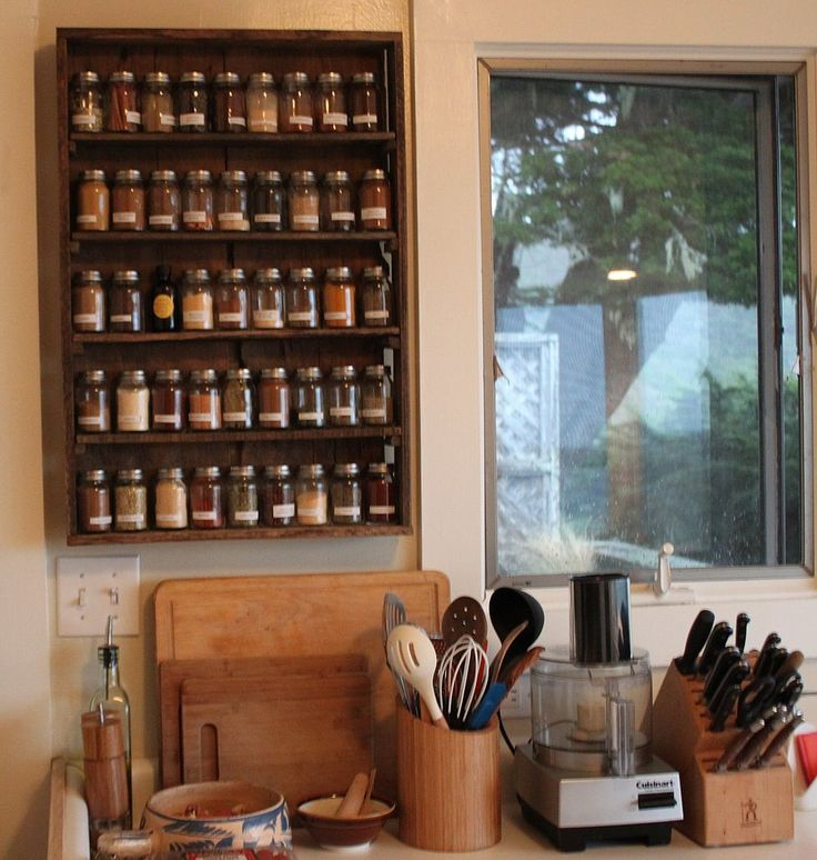 "CS:  Can you tell me more about your fantastic spice rack?  CE: Kai (of course) made the spice rack. He is definitely the cook in our house, and it was important for him to have a very thorough and organized spice rack. It's made out of reclaimed ""tasting sticks"" (wood that was used to flavor wine as though it were aged in oak barrels)."