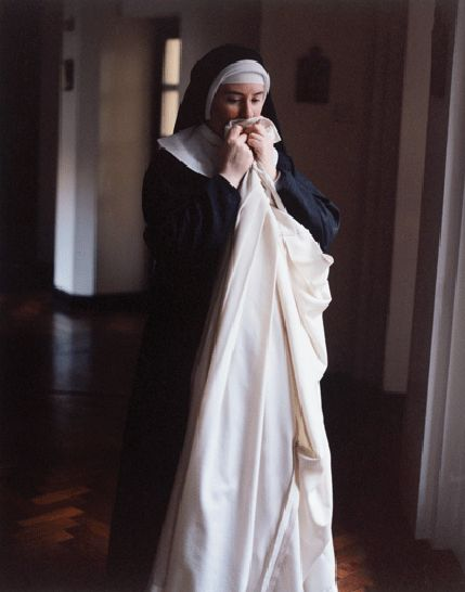Tyburn silent Benedictine order, London. Seven times a day the nuns celebrate this ritual, each at their own pace: they kiss the cowl before putting it on to enter the chapel.